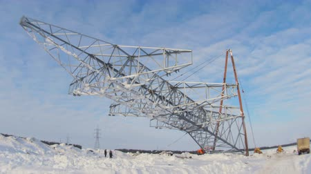 watt : workers install high voltage line support pulling by mechanisms