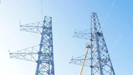 watt : electric towers installation for transmission line under clear sky