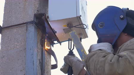 watt : worker carries out welding on concrete support