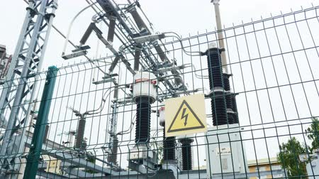 watt : substation with danger warning sign and ceramic insulators