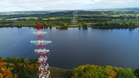 watt : towers of electricity transmission line against autumn landscape Stok Video