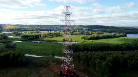watt : tension tower with phase transposition of power line against landscape Stok Video