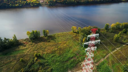 watt : view from above structure supports overhead power line on lake bank Stok Video