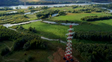watt : alternating current transmission towers above green fields Stok Video
