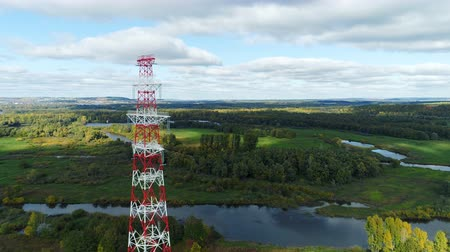 watt : tower carries electric conductors against green landscape
