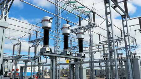 powerline : large electrical transmission station with cables and insulators