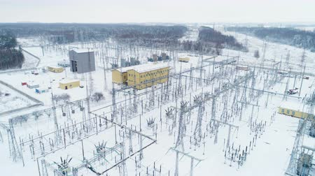 direct current : high voltage substation distributes current against forests Stock Footage