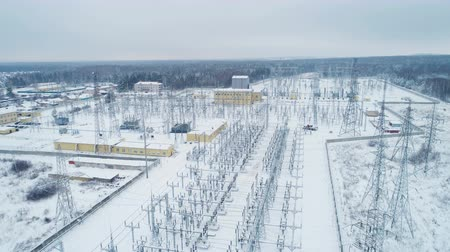 watt : white territory of electricity transmission substation with towers