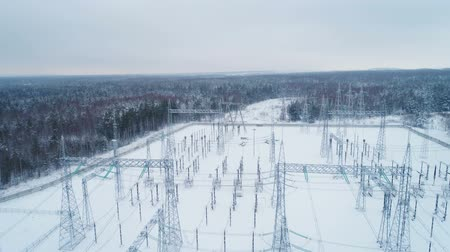 watt : substation distributes current against trees covered with snow
