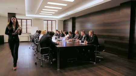 meeting negotiate : company management negotiates at meeting in modern office