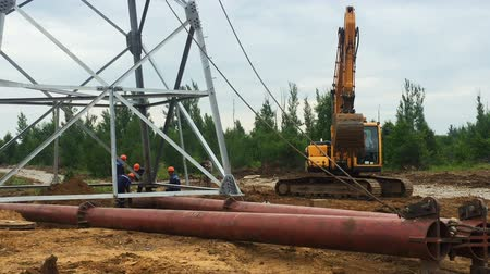 izolace : workers install construction lifted by mechanism with cable