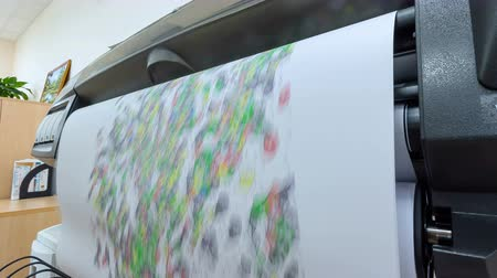 toner : large plotter prints colorful city maps in office Stock Footage