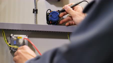 tester : electrician connects to resistors using special tool to measure voltage