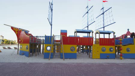 desenvolvimento : modern children playground in ship shape on city beach Vídeos