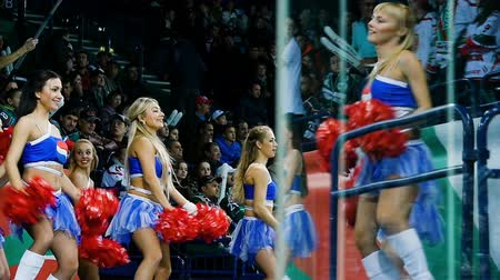 pozdravit : slow motion cheerleaders dance near stands at intermission