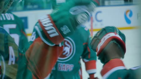 striker : slow motion close view hockey players greet punching gloves