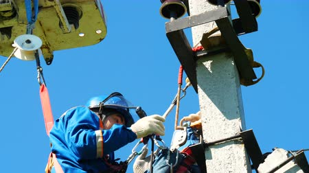 lineman : worker installs equipment on electric pole top at competitions Stock Footage