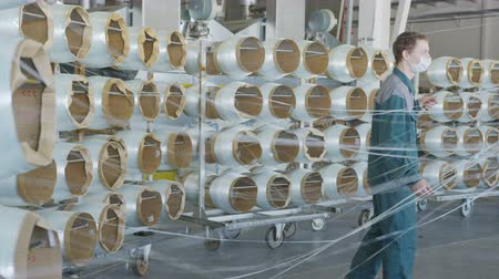 anyag : fiberglass bobbins unwind threads move and workers monitor process