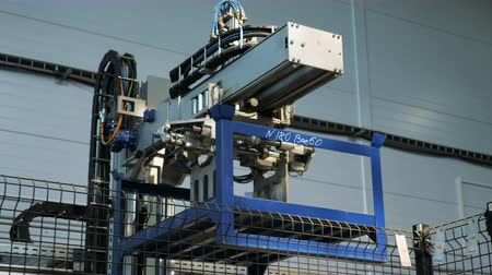 nikl : modern robotic machine transports blue detail at plant