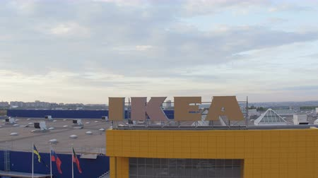 retailer : upper view IKEA store building facade under cloudy sky Stock Footage