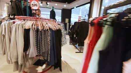 fashion outlet : motion along fashion store with rich clothes selection Stock Footage