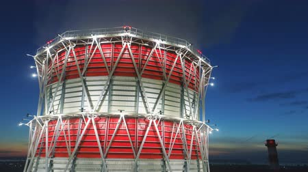 veneno : bird eye view cooling tower at led light and dawn above city