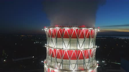 veneno : camera rises above cooling tower at plant in early morning