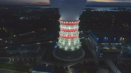 pilon : aerial panorama cooling tower with rising steam against city