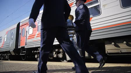 trofej : slow motion people in uniform walk with huge cup along train Dostupné videozáznamy