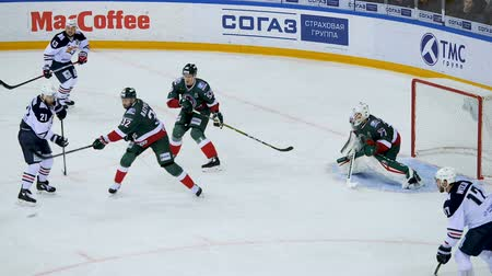 улов : slow motion shot on goal and goalkeeper catching puck