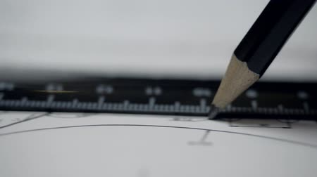 close view designer draws with pencil and ruler on paper Stock Footage
