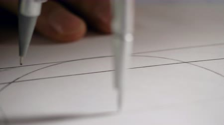 close view circle drawn with compass on project sketch Stock Footage