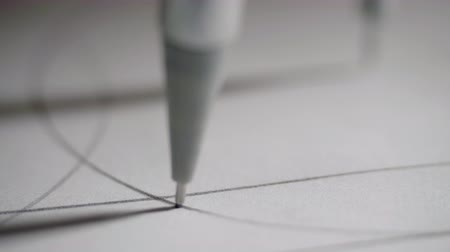 geometry compass : macro man draws circle focus changes from needle to head Stock Footage