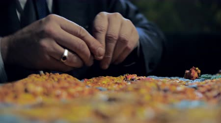 close man makes beautiful sunflowers with colored plasticine Stock Footage