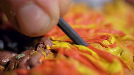 macro artist makes sunflower with plasticine and tool