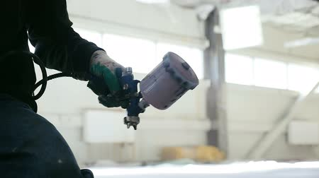 air pump : slow motion hand paints with pulverizer in warehouse Stock Footage