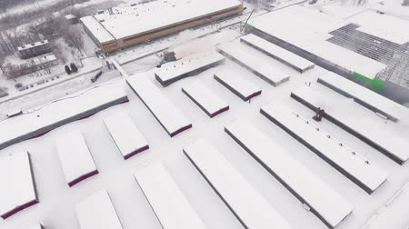 厄介な : aerial motion over production plant covered with snow
