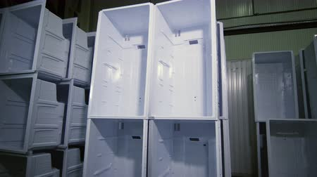 refrigeração : stacks of inner cases for domestic fridges in plant storage