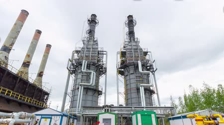 petroleum refinery : production towers at gas and oil refinery plant timelapse