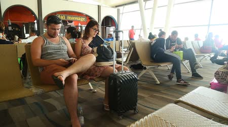 reclaim : Phuket, Thailand - February 23, 2017: Man and woman at the airport waiting