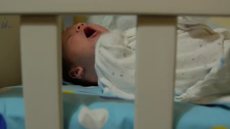 ilginç : Newborn Baby Lying On The Bed Stok Video