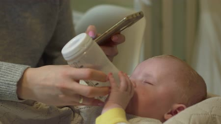 bottle feeding : Mother Feeding Baby milk Stock Footage
