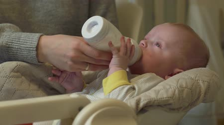 bottle feeding : Baby Eats From Bottle Stock Footage