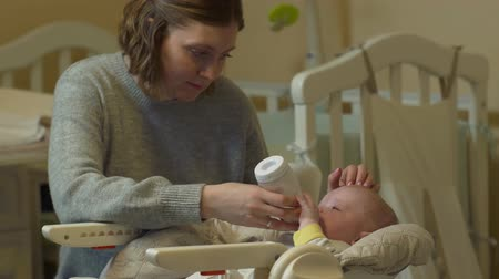 bottle feeding : Mother Feeds Baby Bottle Stock Footage