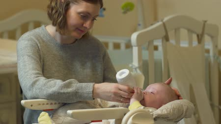 bottle feeding : Mother Feeds Bottle Baby