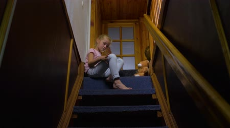 resentment : Little Girl Sitting On Stairs Stock Footage