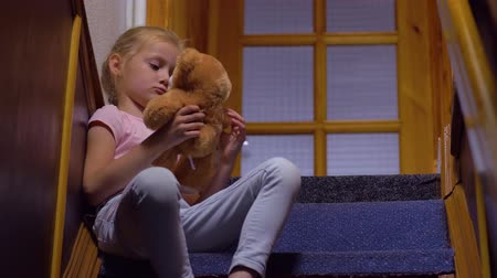 resentment : Sad Girl Play With Teddy Bear Stock Footage