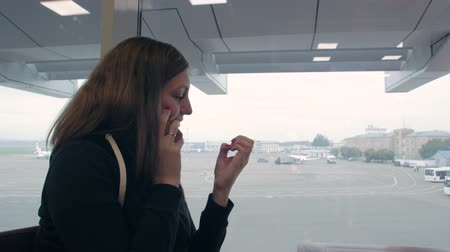 Girl Talking On Phone At Airport Stok Video