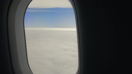 aircraft cabin : The Airplane Flies Above Clouds