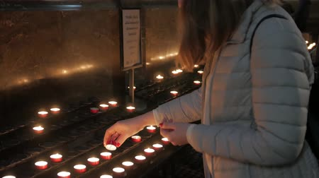 chapel : Girl Lights A Candle In Church